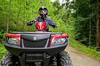 A single male ATV quad rider makes his way down the trail near Powell river on the upper Sunshine coast, Vancouver coast and mountain range, British C...