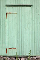 A pale green wooden door