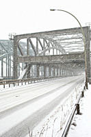 A snowstorm across a road bridge