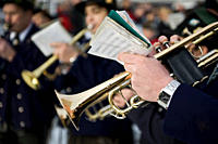 Person playing a trumpet in a marching band