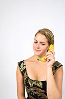 Woman on banana phone looking down
