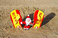 Flip flops and santa on beach in Spain