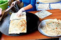 Turkey, Milas, Market, woman preparing a flat bread snack called Gozleme
