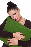 Young woman hugging cushion