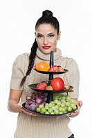 Young woman holding fruit dish (thumbnail)