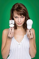 Young woman holding two light bulbs (thumbnail)