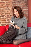Young surprised woman reading text message