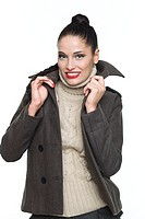 Young woman holding jacket collar