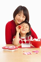 A Mother And Daughter Making Valentine´s Day Crafts