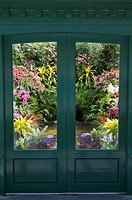 a door to an indoor garden in butchart gardens, brentwood bay, british columbia, canada