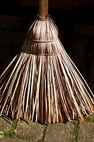 An African flat broom made from natural grass, often sorghum