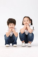 Boy and girl crouching