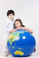 Boy and girl with a globe