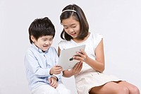 Boy and girl looking at iPad