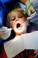 Stock photo of a 10 year old boy sitting in the Dentists chair