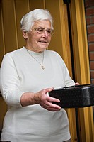 Older woman receiving meals on wheels