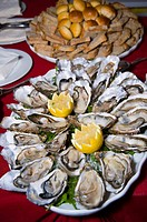 Oysters on table with bread