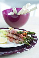 Roasted green asparagus wrapped in ham