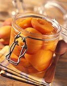 Jar of apricots in syrup