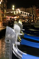 Rialto bridge at night, gondolas in foreground, Venice, Italy, Europe