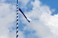 Bavarian flag flying on a Maypole, Bavaria, Germany, Europe