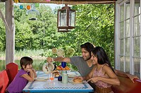 Family having breakfast together outdoors