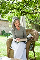Mature woman reading book