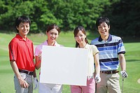 Men And Women Holding White Board On Golf Course