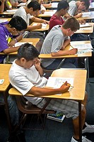 A multiracial Southern California high school class takes a multiple choice test, marking the answers on a Scantron card with a pencil to allow electr...