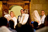 Wearing ceremonial white, a rabbi and congregation members hold Torah scrolls at Yom Kippur service at a California reform synagogue  Known as the 'Da...