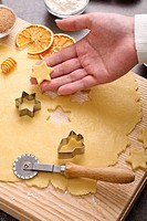 Woman holding cut_out star_shaped cookie dough in her hand
