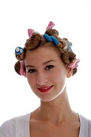 Young woman with foam curlers in her hair