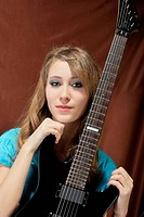 attractive girl with guitar. portrait