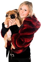 Blond woman in sheepskin jacket holding a pekinese