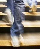 Legs and feet ascending a stairway with motion and blur