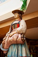 Woodcarving of Alpine woman, Romantik Hotel Schweizerhof, Grindelwald, Canton Bern, Switzerland