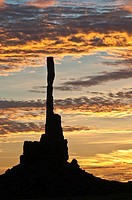 Sunrise with Totem Pole rock formation in backlight, Monument Valley, Arizona, USA