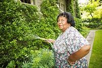 Woman watering garden