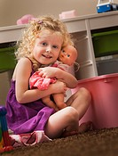 USA, Utah, Lehi, girl 2_3 hugging doll