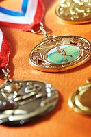 Studio shot of competition medals with ribbons