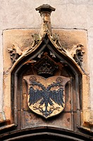 Double eagle and a crown above the entrance of the fruit market, Place du marché aux fruits, Colmar, Alsace, France, Europe