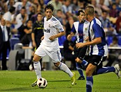 Primera Division, football, test match Hercules Alicante in blue against Real Madrid in white with Mesut Oezil, in Alicante, Spain, Europe