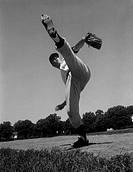 Baseball pitcher standing on one leg