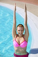 Frau im Swimmingpool, young woman doing acqua gymnastics in the swimming