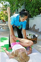 young woman enyoing thai massage in Railay View Point Resort