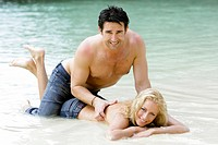 Couple in love enjoying holidays at tropical beach in