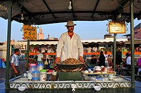 Man selling snails boiled in water from a stall on the Djema el Fna, Marrakech, Morocco, Africa