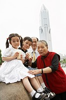 Chinese grandparents enjoying grandchildren
