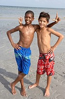 Playful boys enjoying the beach together