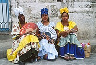 Cuba, Havana, women in traditional dress,